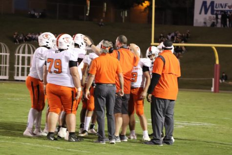 Defensive coordinator Justin Dubruiel taking a timeout to talk with his defense.