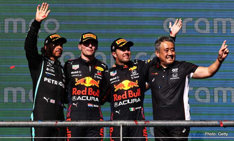 AUSTIN, TEXAS - OCTOBER 24: Race winner Max Verstappen of Netherlands and Red Bull Racing, second placed Lewis Hamilton of Great Britain and Mercedes GP, third placed Sergio Perez of Mexico and Red Bull Racing and Masashi Yamamoto of Honda celebrate on the podium during the F1 Grand Prix of USA at Circuit of The Americas on October 24, 2021 in Austin, Texas. (Photo by Chris Graythen/Getty Images)